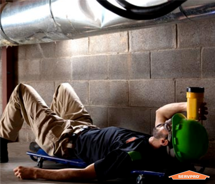 SERVPRO expert examining an air duct at a commercial property