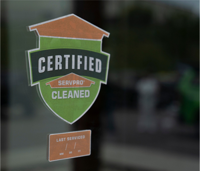 Certified: SERVPRO Cleaned Sticker Stuck Proudly to a Storefront Window